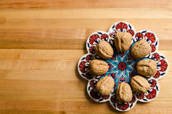 Walnuts for display on chopping board. Image of some walnuts on display on pretty dish royalty free stock photo
