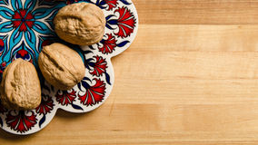 Walnuts on display. Image of some walnuts on display on pretty dish Royalty Free Stock Photos