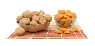 Walnuts and dried apricots on a white background Royalty Free Stock Image