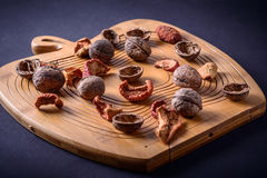 Walnuts and dried fruits on a wooden board Stock Photography