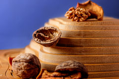 Walnuts and dried fruits on a wooden support in the form of a pyramid Stock Photos