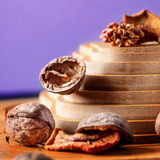 Walnuts and dried fruits on a wooden support in the form of a pyramid Stock Photography