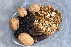 Walnuts and dry fruit on plate Royalty Free Stock Images