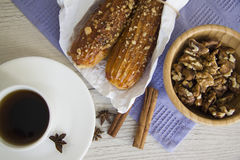 Walnuts and eclairs Royalty Free Stock Photo