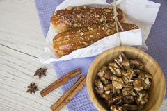Walnuts and eclairs Royalty Free Stock Images