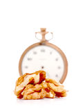 Walnuts in front of vintage pocket clock. time and food concept Royalty Free Stock Photography