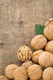Walnuts fruit on wood background Royalty Free Stock Photos