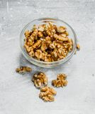 Walnuts in a glass bowl. On a rustic background royalty free stock photos