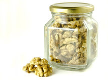 Walnuts in a glass jar Royalty Free Stock Images