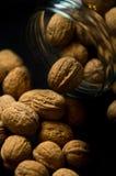 Walnuts in glass jar stock image