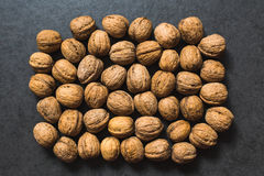The walnuts on a gray surface Stock Photos