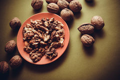 Walnuts on green background Royalty Free Stock Photo