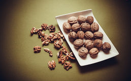 Walnuts on green background Stock Image