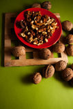 Walnuts on green background Royalty Free Stock Images