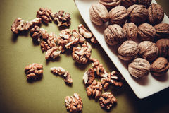 Walnuts on green background Stock Photography