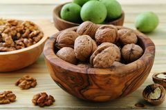 Walnuts green and dry on kitchen table background royalty free stock photo