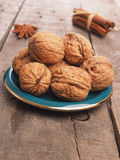 Walnuts on a green plate Stock Photo