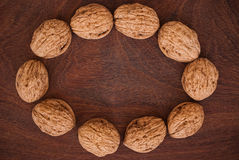 Walnuts. Half walnuts on wooden background Stock Photo