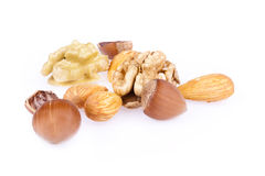 Walnuts, hazelnuts and almonds. Isolated on a white background Royalty Free Stock Photo