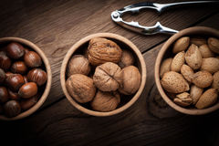 Walnuts, hazelnuts and almonds in-shell in wooden bowl. Royalty Free Stock Photo