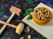 Walnuts and hazelnuts in composition on dark background royalty free stock image