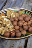 Walnuts and hazelnuts. In an old bowl in a rustic farmhouse stock photo