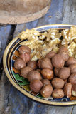 Walnuts and hazelnuts. In an old bowl in a rustic farmhouse stock photos