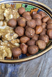 Walnuts and hazelnuts. In an old bowl in a rustic farmhouse royalty free stock image