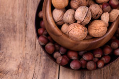 Walnuts and hazelnuts on rustic wooden background Stock Photography