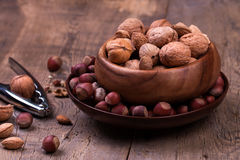 Walnuts and hazelnuts on rustic wooden background Royalty Free Stock Images