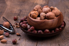 Walnuts and hazelnuts on rustic wooden background Royalty Free Stock Photo