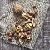 Walnuts and hazelnuts on wooden Stock Image