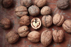 Walnuts and a heart Stock Photos