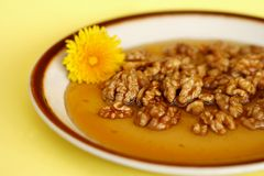 Walnuts in honey Stock Photo