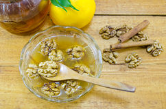 Walnuts honey and lemon on a table Royalty Free Stock Images