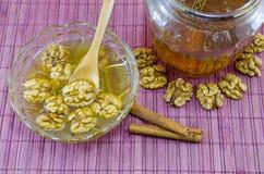 Walnuts honey and lemon on a table Royalty Free Stock Photos
