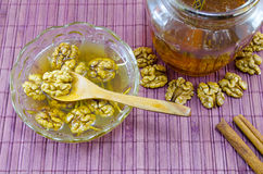 Walnuts honey and on a table Stock Image