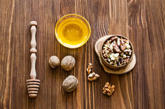 Walnuts and honey Stock Photos
