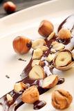 Walnuts in hot dark chocolate Royalty Free Stock Photo