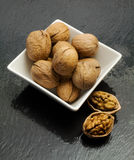 Walnuts inside  a ceramic bowl Stock Photos