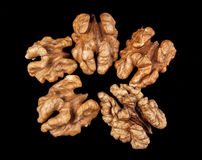 Walnuts isolated on black background. Close-up view Royalty Free Stock Image