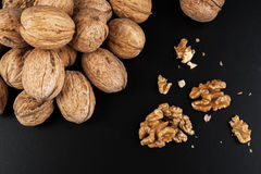 Walnuts isolated on black background. Close-up view Royalty Free Stock Images