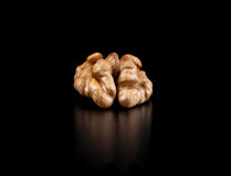 Walnuts isolated on black background. Close-up view Royalty Free Stock Photography