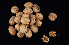 Walnuts isolated on black background. Close-up view Stock Photos