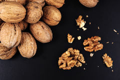 Walnuts isolated on black background. Close-up view Stock Image
