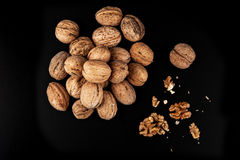 Walnuts isolated on black background. Close-up view Stock Photography