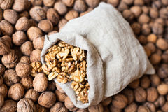 Walnuts kernels in the sack on the pile of walnuts Stock Image