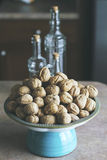 Walnuts with kitchen background Stock Photo