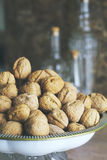 Walnuts with kitchen background Stock Photography