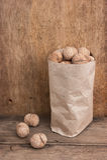 Walnuts in a kraft paper bag stock photos